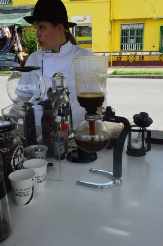 woman with coffe laboratory on a table guatape