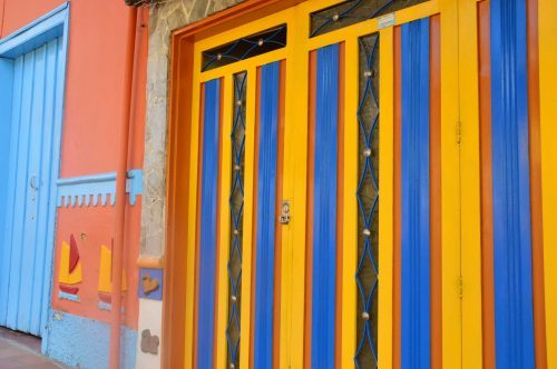 brightly colourful doors on colourful street guatape