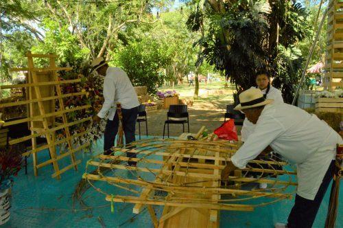 men preparing the wooden base