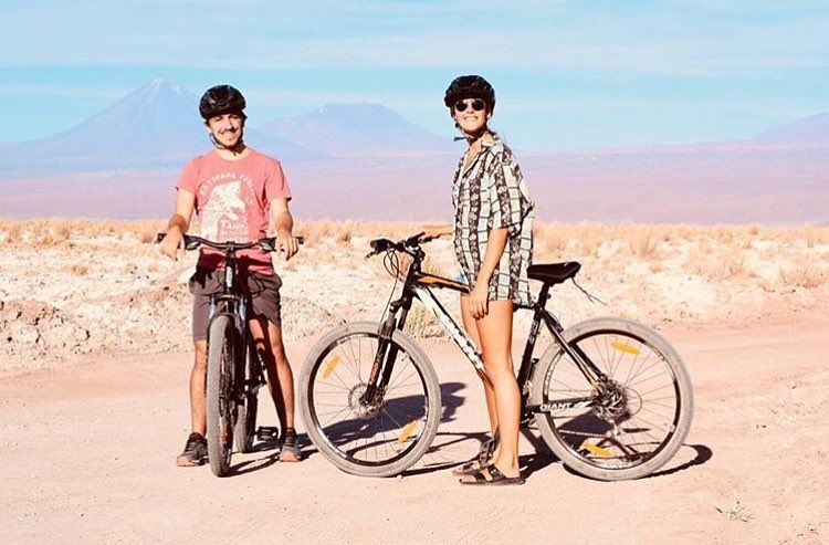 2 cyclicsts on bikes in the atacama desert chile