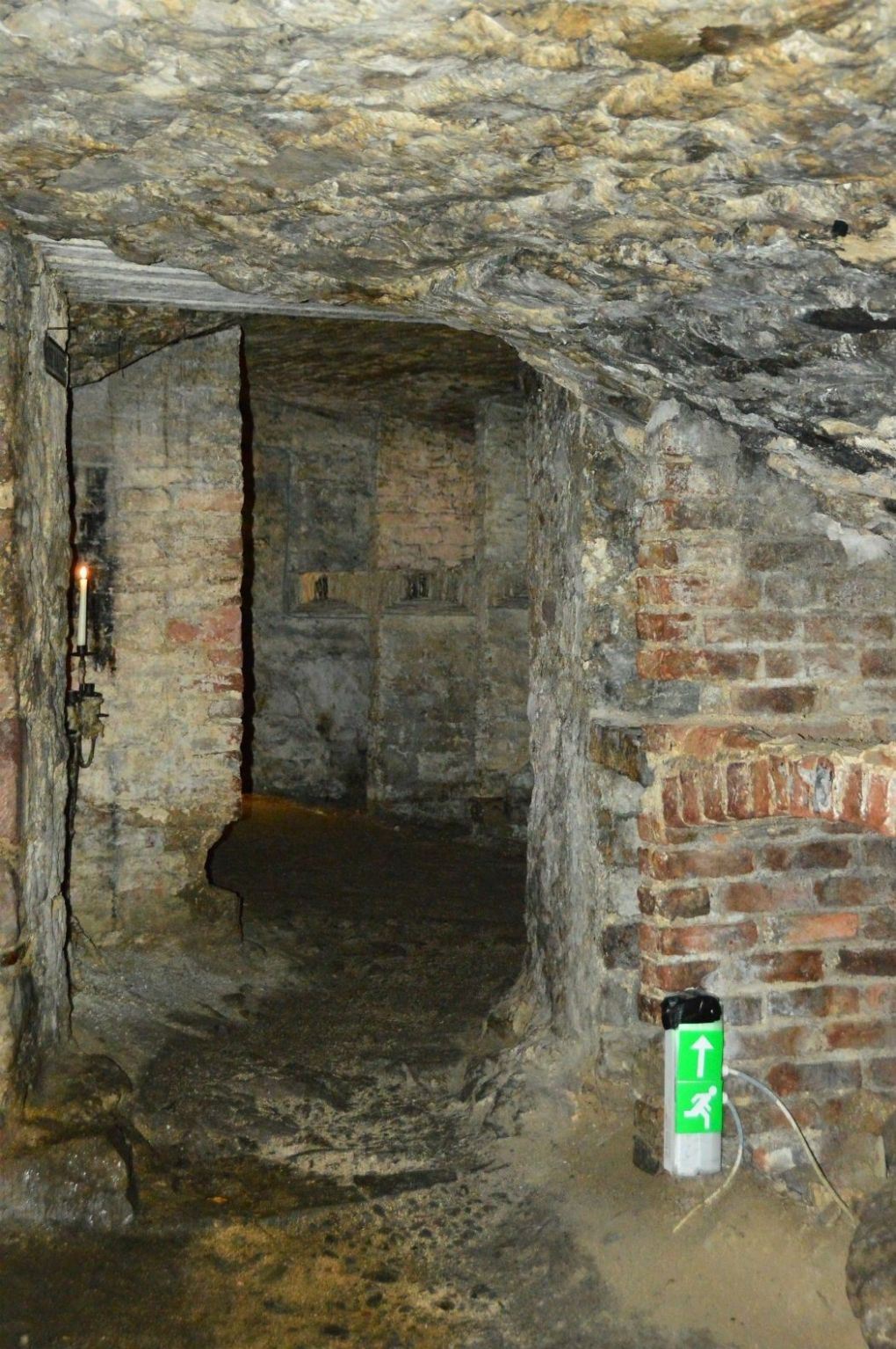 stone corridor with candle on the edinburgh vaults tour