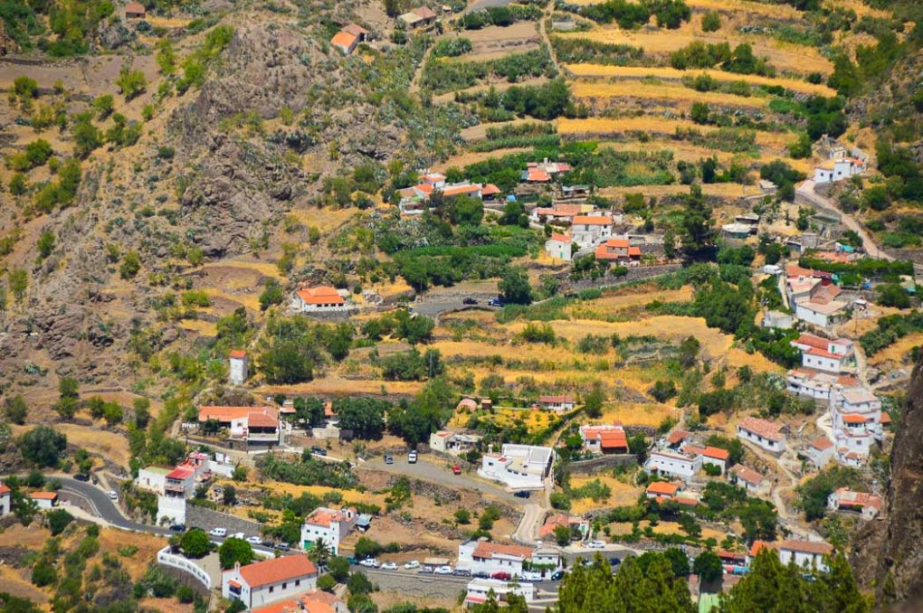 small houses with coral roofs on a hill in gran canaria
