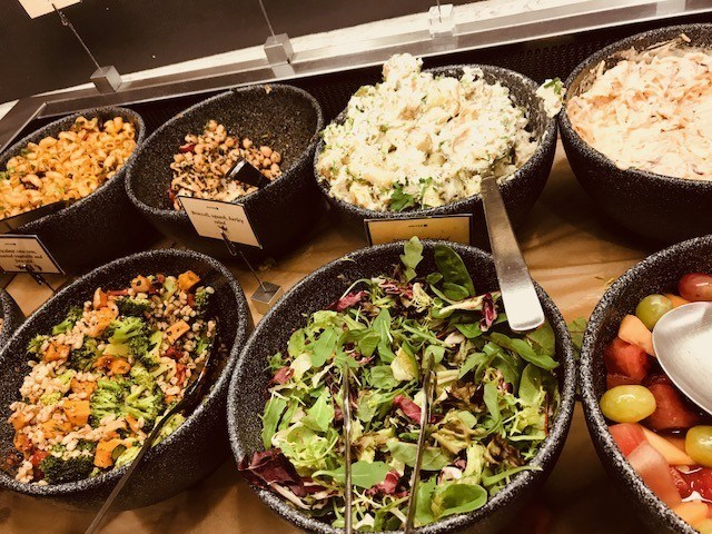 different salads on display in united airlines lounge heathrow terminal 2