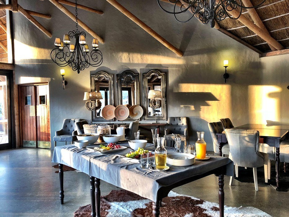 inside the kwandwe restaurant with a table set up for a breakfast buffet