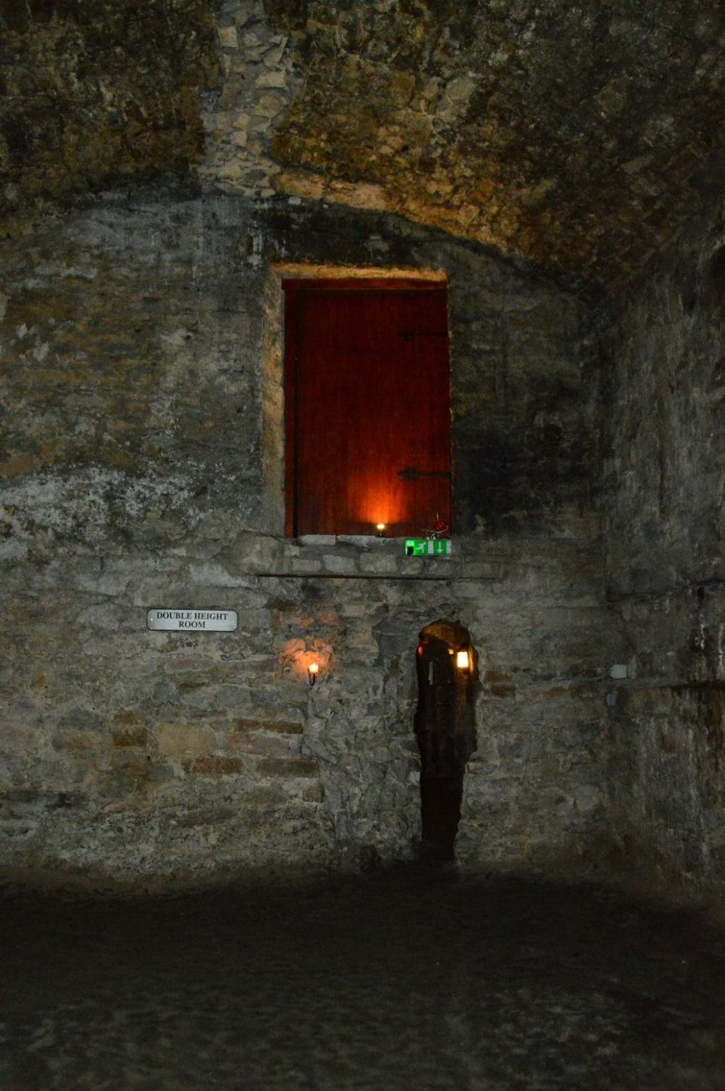 inside the edinburgh vaults with one candle light