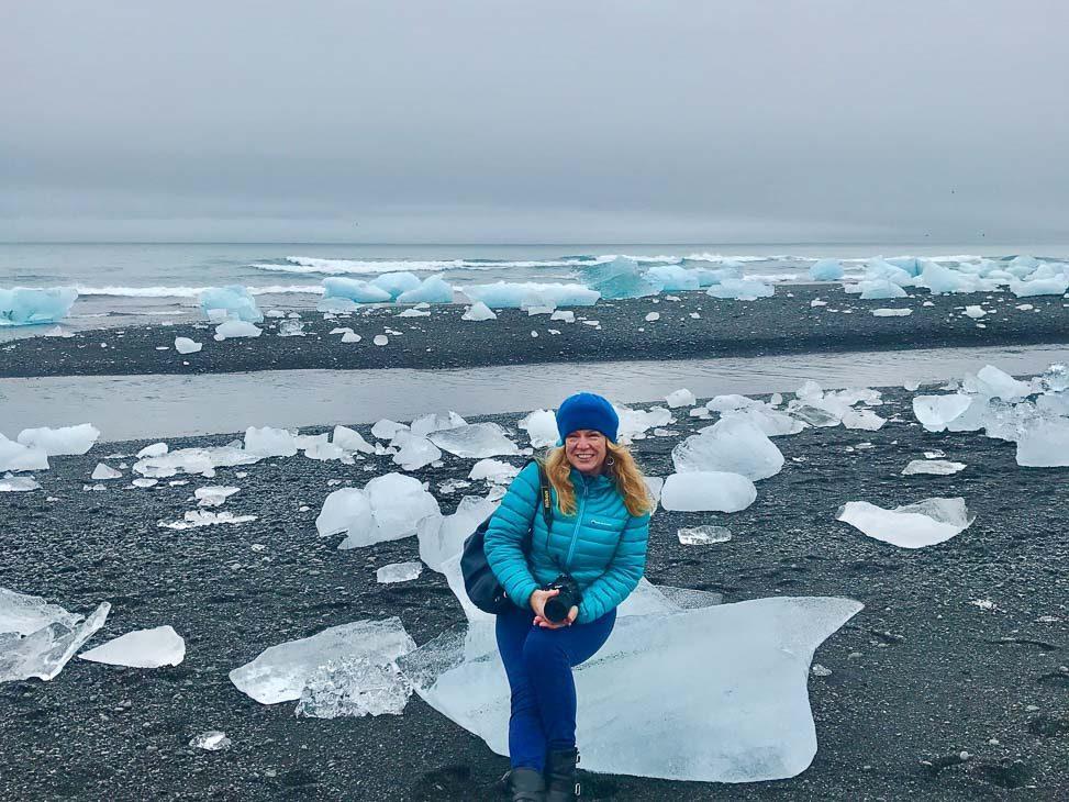 woman at diamond beach iceland