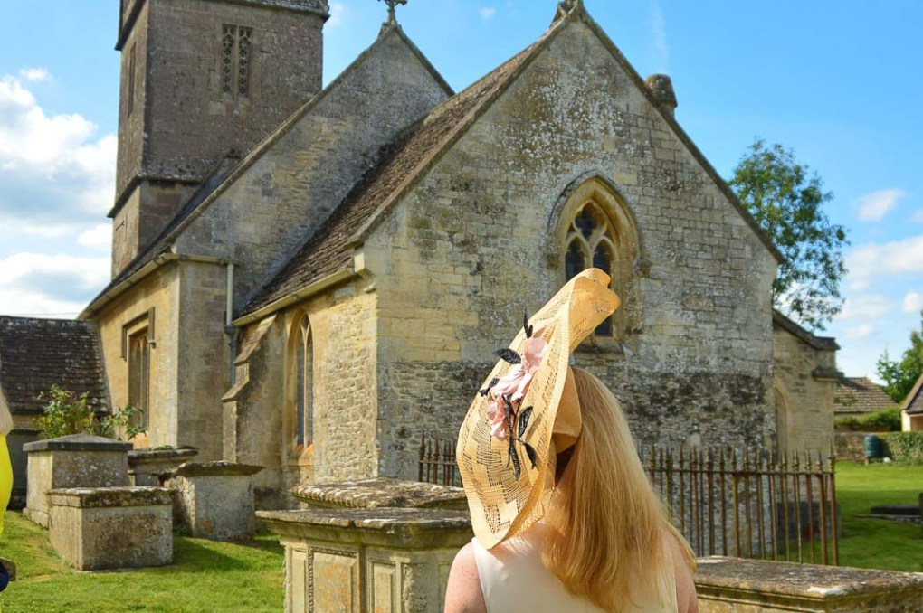 woman from behind in hat with church