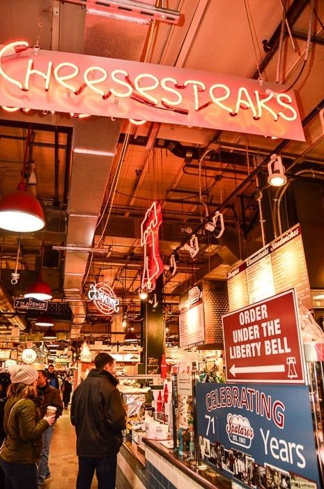 cheesesteaks neon sign at reading terminal market