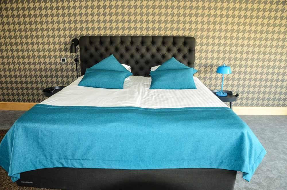 Bed in room at Hotel Kurshi Jurmala Latvia
