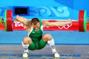 BEIJING - AUGUST 13: Janos Baranyai of Hungary screams in pain after dropping the weights during the Men's 77kg weightlifting competition event at the University of Aeronautics and Astronautics Gymnasium during Day 5 of the Beijing 2008 Olympic Games on August 13, 2008 in Beijing, China. (Photo by Phil Walter/Getty Images) Original Filename: 82279163.jpg