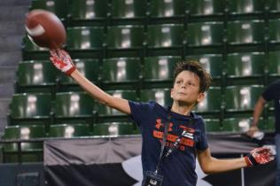 Tom-Brady-shows-no-mercy-jukes-out-son-in-backyard-football
