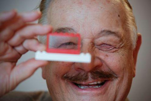 John Peddie holds one of the first Australian LEGO bricks