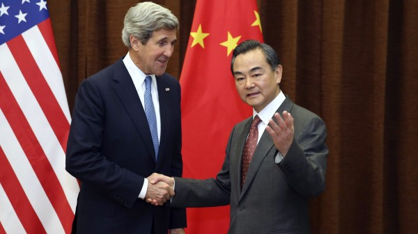 Kerry, seen here with with Chinese Foreign Minister Wang Yi in 2013, is likely to press the issue of South China Sea access [Xinhua]