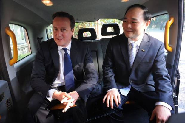 UK Prime Minister David Cameron with Geely Chairman Li Shufu. The maker of London's iconic black taxis has been saved from closure after Chinese car maker Geely bought out the company for $17.2 million [Xinhua]