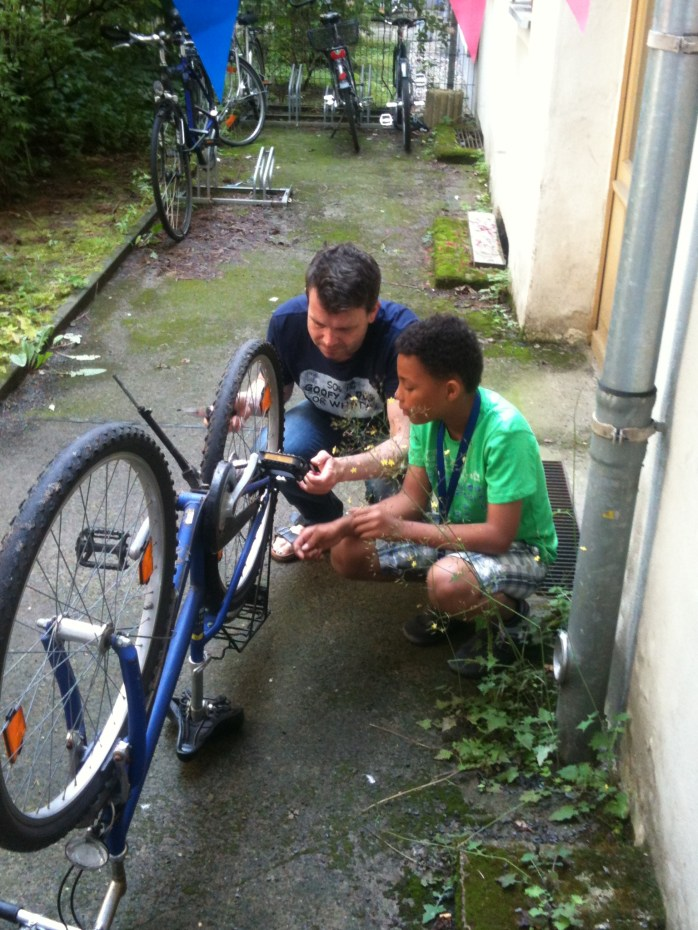 "The Music Producer and ""The Tall Young Gentleman"" - Fixing bikes. As boys do!"