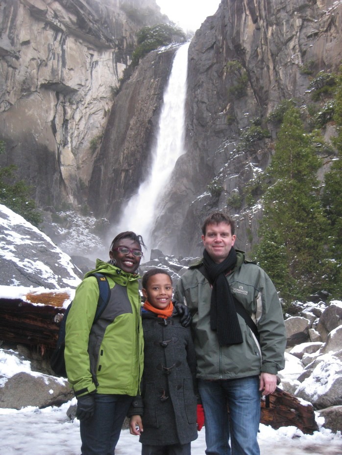 My family under the waterfall in Yosemite National Park - USA