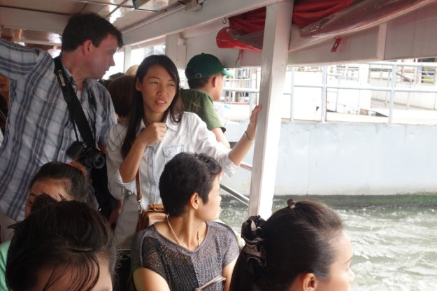 """The Music Producer"" and Cherie, on one of the longtail boats!"
