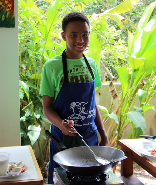 """The Tall Young Gentleman"" doing a marvellous job at cooking."