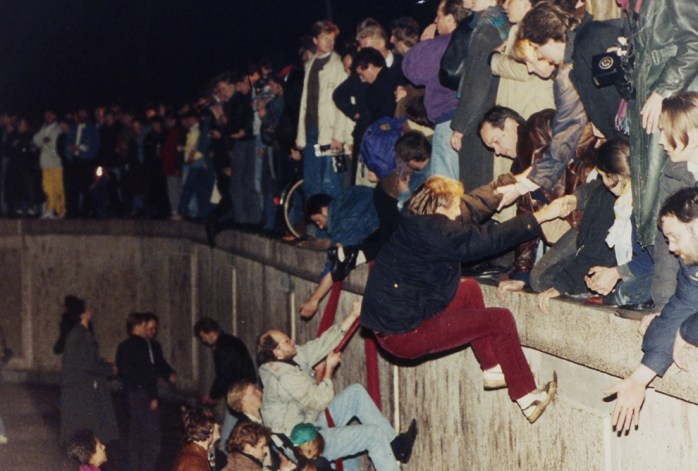 Climbing up the Berlin Wall; After the Fall of the Berlin Wall; Berlin Wall; Mauerfall; Brandenburg Gate; Brandenburger Tor; Gate; Tor; Brandenburg; Berlin; Germany; Federal Republic of Germany; Festival of Lights; Freedom; Identification; FRG; GDR; DDR; German; German Democratic Republic; Reunification; German Reunification; Nur Mit Euch; Only With You; October 3rd; 1989; Tag der Deutschen Einheit; der Deutschen Einheit; Deutschen Einheit; Deutsche; Deutsche; East Germany; West Germany, the Germans; Germans; die Deutschen; Mauer; After the Fall of the Berlin Wall; Europe; Travel;