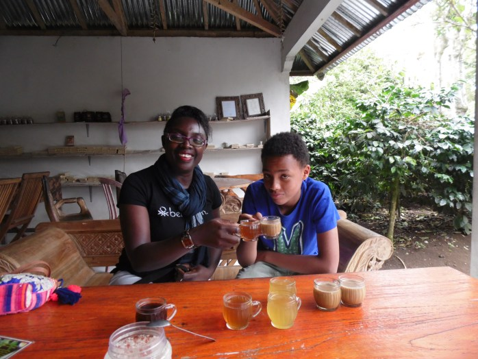 Clinking glasses while drinking exotic beverage after an exhausting hike, on top of a volcano. In Bali! Phew! We made it!