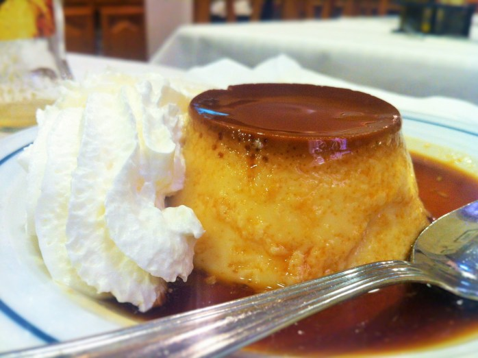 Spanish crème caramel or caramel custard, with a huge dollop of whipped cream!