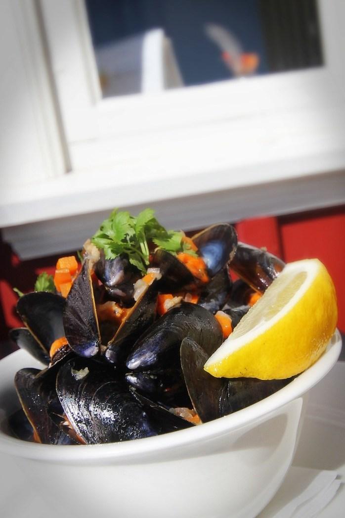 Belgian mussels flowing in lemon and wine!