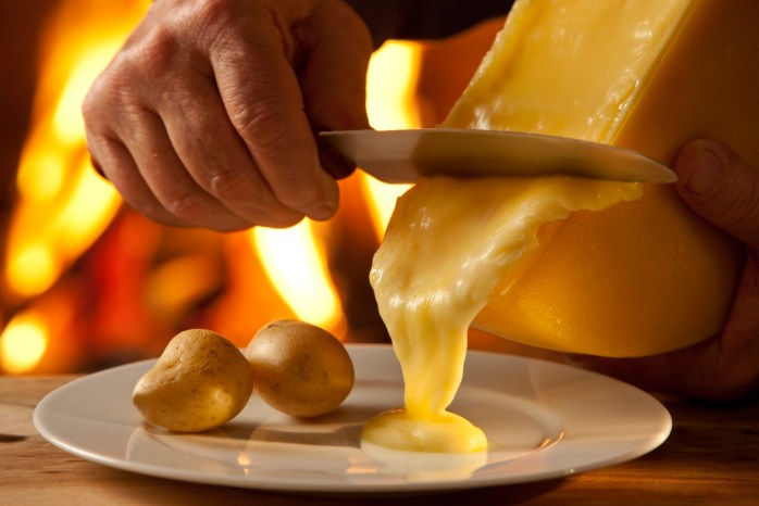 Raclette - food covered in molten or scalloped cheese! Why you should visit Switzerland, and eat cheese!