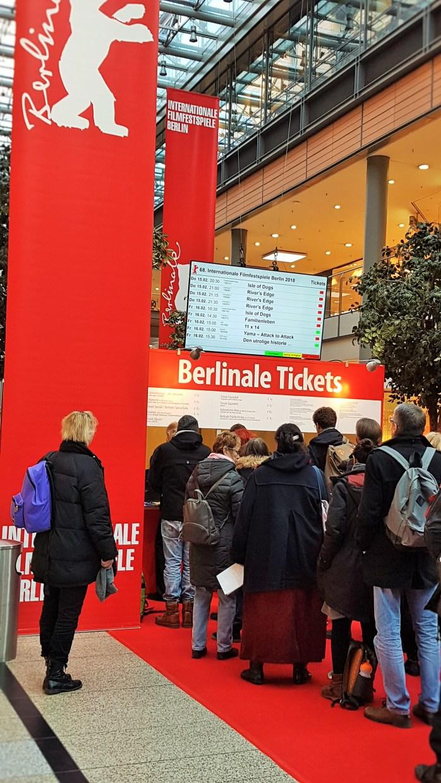 film ticket; ticket; people buying tickets; people buying Berlinale film tickets; Berlinale; 70th Berlinale; Berlin International Film Festival; Internationale Filmfestspiele Berlin; International Film Festival; Film Festival; film; films; movies; festival; Berlin Films; Berlin; Germany
