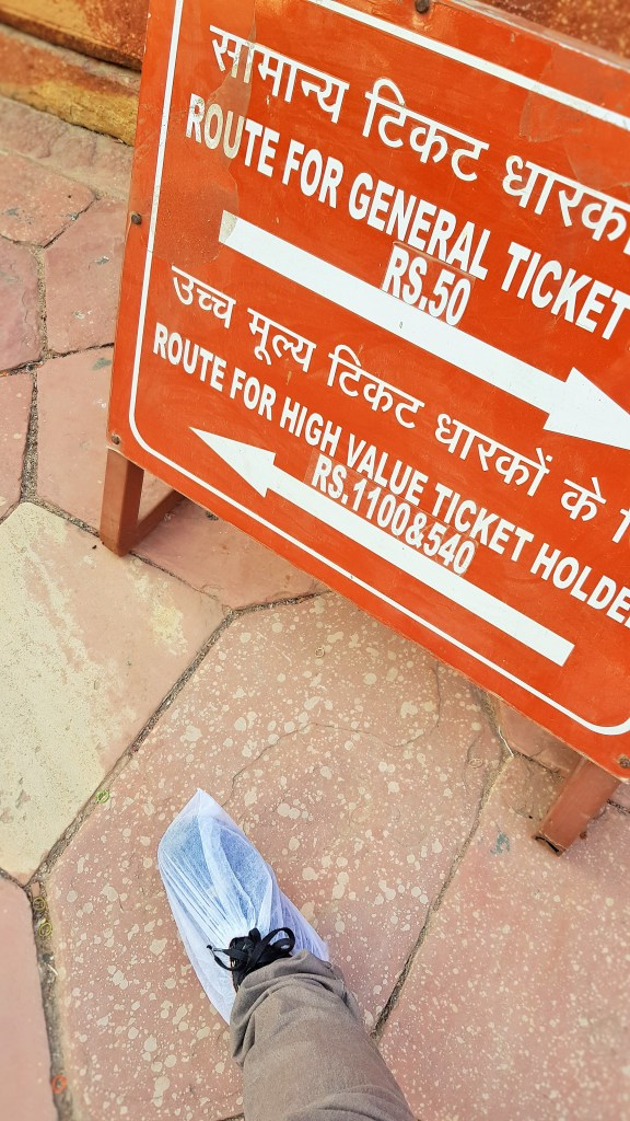Shoe covers to the monuments at the Taj Mahal in Agra, India; High value ticket holder; high value tickets; high value; Taj Mahal; Agra; India; shoe covers; protective cover; plastic shoes
