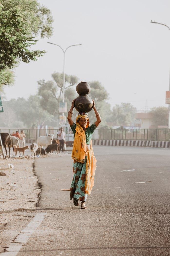 walk; walking; Indian woman; woman; Indian woman walking; pots on heat; pots; Indian culture; culture; Jaipur; Pink City; Rajasthan; Land of Kings; heritage; India; Indian
