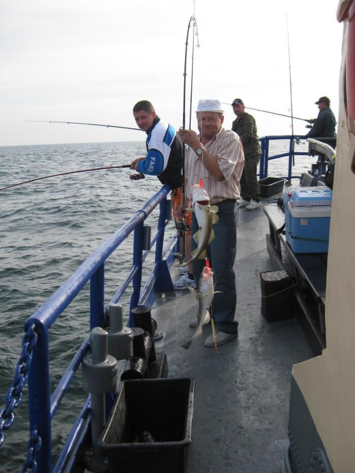 Polish fishermen; fishermen; fisherman, fishing; fish; seafood; food; Polish men; men; Polish Baltic Sea; Baltic Sea; Ost See; Pomerania; sea; open water;
