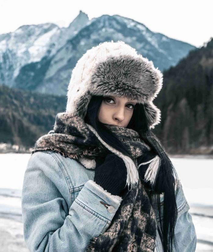 girl in snow; woman in snow; woman with furry hat; Norway; Norwegian; Nordic; Europe; family travel; travel;