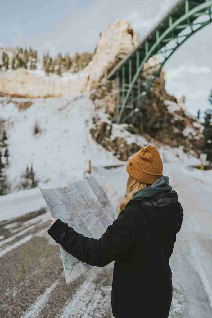 Norway; snow; which way; directions; map; girl with map; woman with map; mapping; Norwegian; Nordic; Europe; family travel; travel;