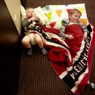 ...pretending to sleep in the hallway!