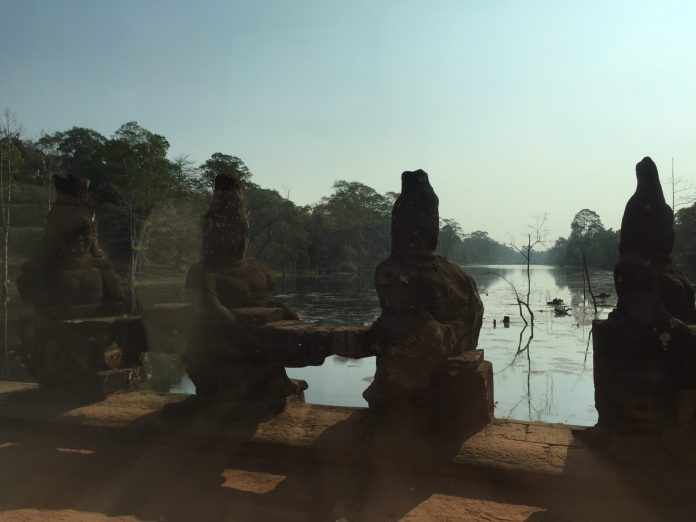 The bad side statues in the bridge leading to Angkor area, Siem Reap