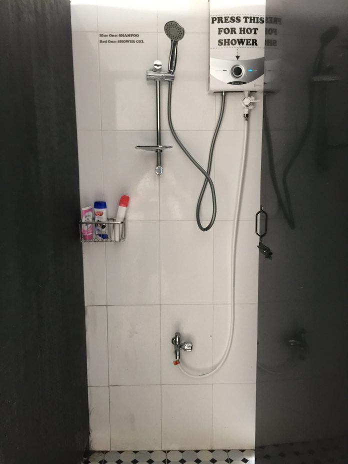 washroom with shampoo, shower gel, facial cleanser provided at O.M.E hostel - Quy Nhon, Vietnam
