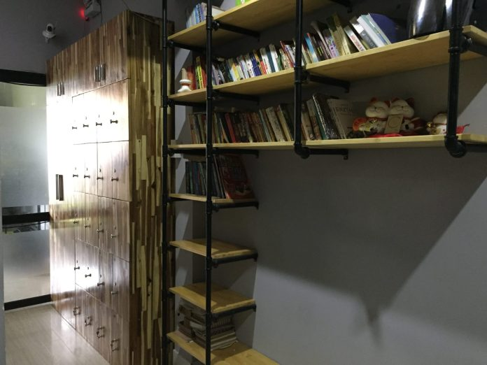 bookshelf and lockers at O.M.E hostel - Quy Nhon, VIetnam