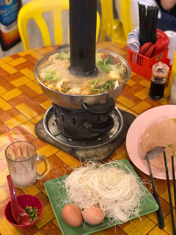 the Charcoal Steamboat after added meats and vegetables, a signature dinner at Cameron Highlands, Malaysia