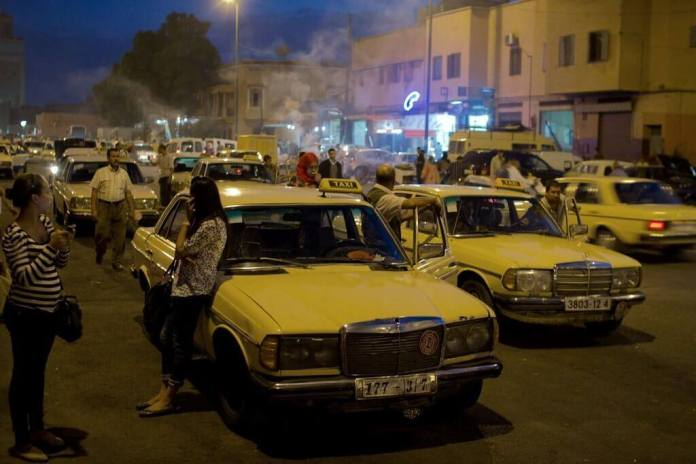 taxi drivers at marrakesh city, morocco