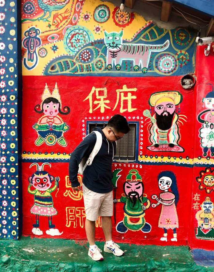 taking pic with colorful background at Rainbow Village, Taichung, Taiwan