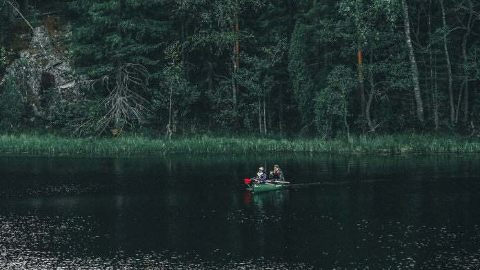 kayaking on a lake inside forest
