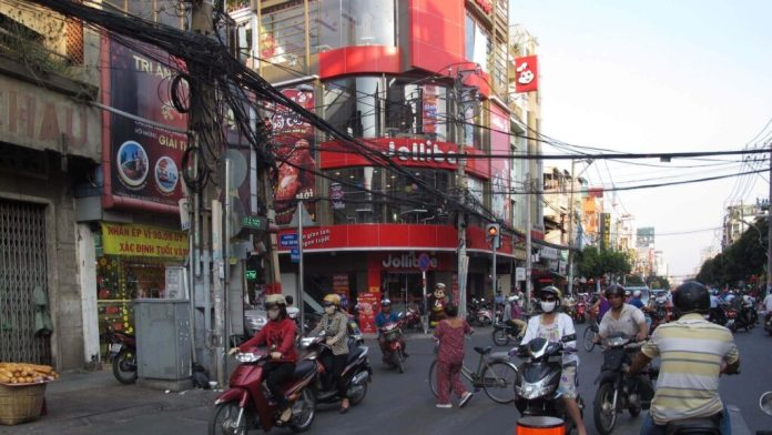 A Jollibee store at Cach Mang Thang Tam street, the part of Tan Binh district
