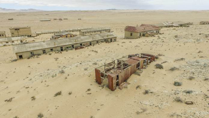 abandoned houses at the ghost town kolmanskop flooded by sand