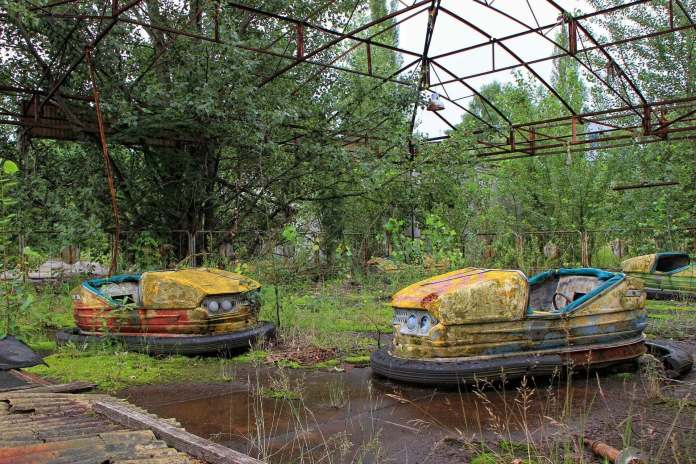 forgotten bumper car in Chernobyl, one of the well-known abandoned places across the world