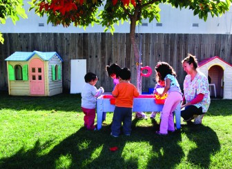 Lupita Fernandez, right, watches over her charges at her Migrant Head Start childcare at her Watsonville, California home, November 2, 2011. (Shmuel Thaler/Santa Cruz Sentinel/MCT)