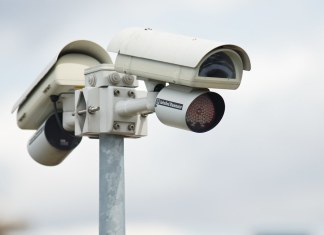A security camera for surveillance, comparable to encryption backdoors, which use public surveillance to spy on your conversations.
