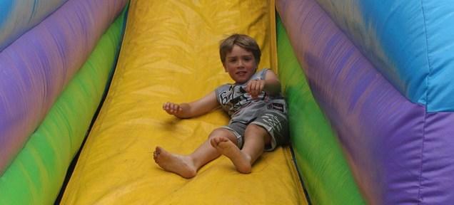 Boy on bouncy slide