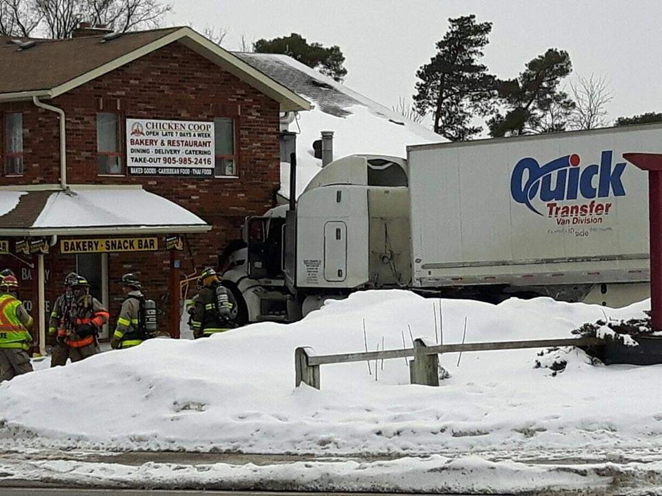 Man charged with careless driving after transport truck slams into Greenbank business