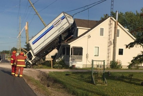 Driver charged after commercial vehicle lands on house near Sudbury