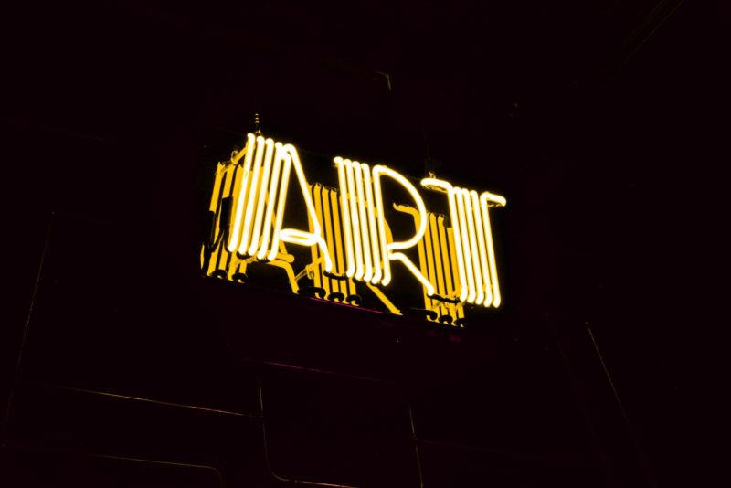 minimalist photography of yellow art neon light signage